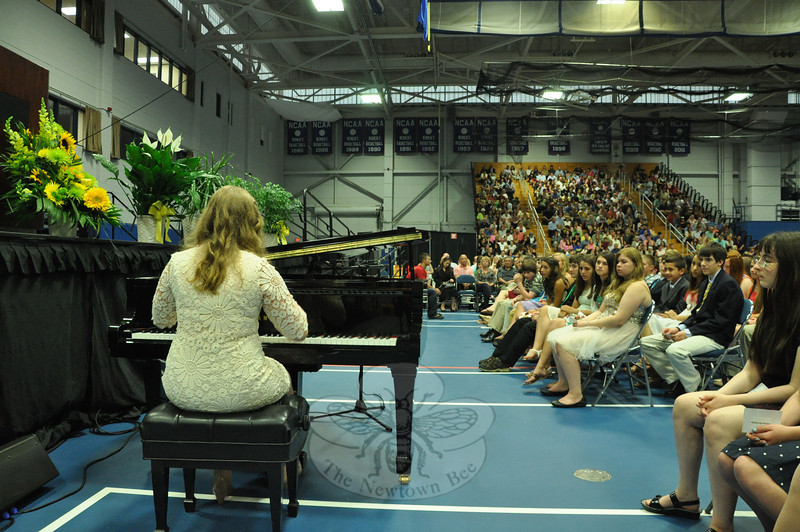 "NMS eighth grade student Aysha Hafiz played a rendition of Henry Mancini's ""Love Story"" on a piano staged at the foot of the rostrum. Her inspired performance won a lengthy round of applause, which Aysha obliged with an modest curtsy before returning to her seat on the stage."
