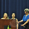 "Graduating eighth graders Claire Beiter and Julia Bogdanoff performed the ""Star Spangled Banner,"" with help from NMS Principal Diane Sherlock following a technical diffculty, during the moving up ceremony.   (Dietter photo)"