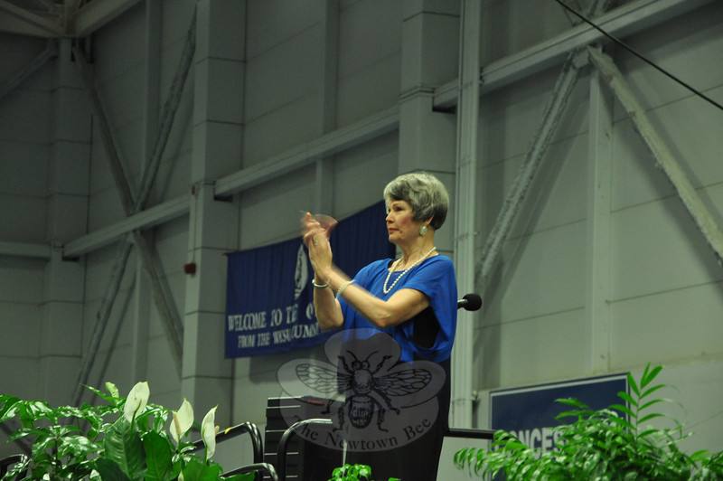 Newtown Middle School Principal Diane Sherlock, scheduled to retire after the school year ends, claps during the Newtown Middle School's Moving-Up ceremony on June 18 at Western Connecticut State University.   (Dietter photo)