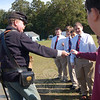 Civil War Reenactor Bob Graves passes a piece of hardtack around students to feel how hard it was during his visit to St Rose last week. (Bee Photo, Hallabeck)