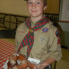 A resourceful scout gets refreshments for his fellow Den members at the St John's Episcopal Church Donut stop. (Bee Photo, Hallabeck)