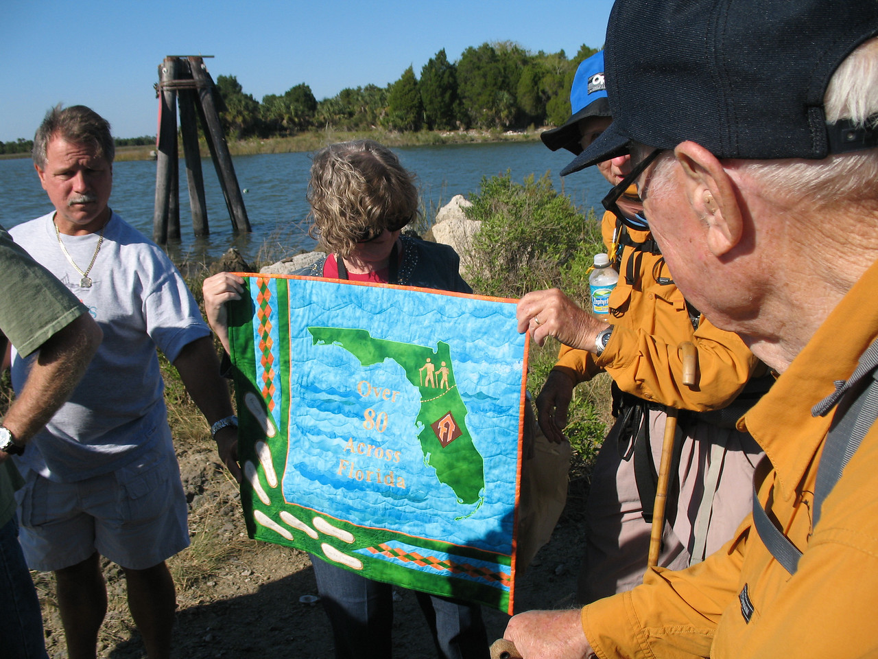 Ken\'s daughter presents him with a commemorative quilt she created