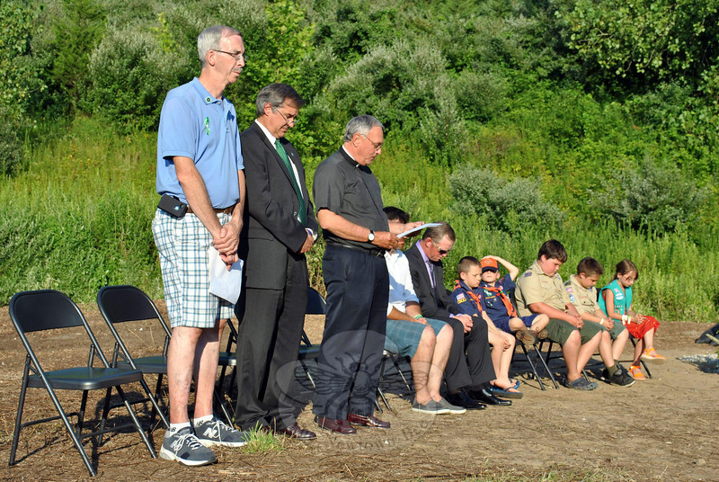 "Organizers for the dedication of the Rock of Angels granite memorial, envisioned by Florida resident Rich Gray and presented to the people of Newtown by craftspeople and residents of Maine, planned a low key ceremony. That is what was delivered early Monday evening, August 12. Approximately 100 people attended the brief dedication ceremony behind St John's Episcopal Church, where the 10-foot by 4-foot stone memorial has found its permanent home, nestled into a natural amphitheater of trees and shrubbery. Read more here, <a href=""http://www.newtownbee.com/news/news/2013/08/13/rock-angels-dedicated-sandy-hook/155249"">http://www.newtownbee.com/news/news/2013/08/13/rock-angels-dedicated-sandy-hook/155249</a>. (Crevier photo)"