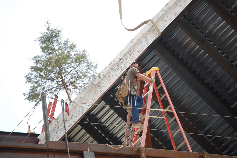 Placing the last steel beam on the building