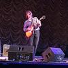 John Idan on guitar and lead vocals.