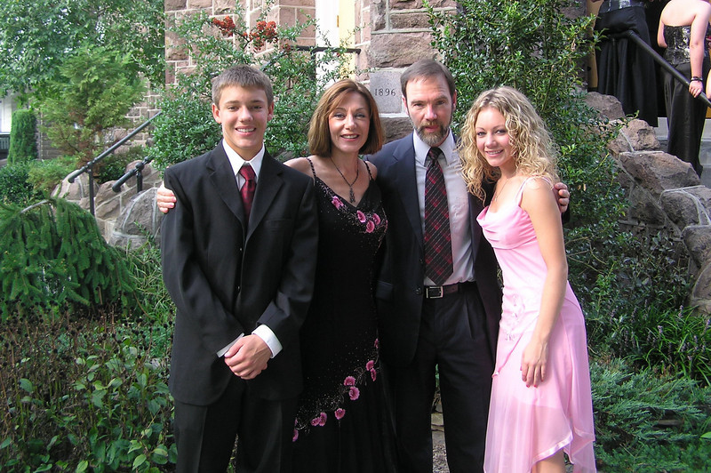 Casey with Mom, Dad & Brett outside the church before the wedding.