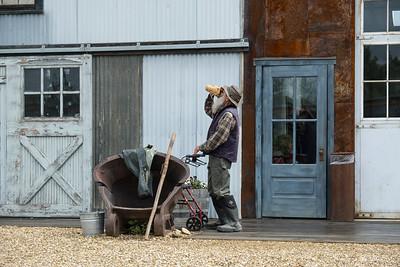 Old timer having a sip at the rear of Gold Dredge 8, Fairbanks, Alaska.
