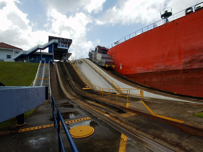 The Orchid Express and her rear right tug leaving the Gatun Lake Lock.