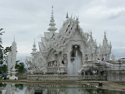 By the end of the 20th century, the original Wat Rong Khun was in a bad state of repair. Funds were not available for renovation. Chalermchai Kositpipat, a local artist from Chiang Rai, decided to completely rebuild the temple and fund the project with his own money. The artist intends for the area adjacent to the temple to be a center of learning and meditation and for people to gain benefit from the Buddhist teachings. Kositpipat considers the temple to be an offering to Lord Buddha and believes the project will give him immortal life.