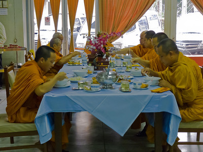 The Monks who will perform the ceremony and prayers are having breakfast.
