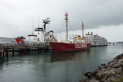 The American Pride at dock with Coast Guard vessels in Astoria, OR.