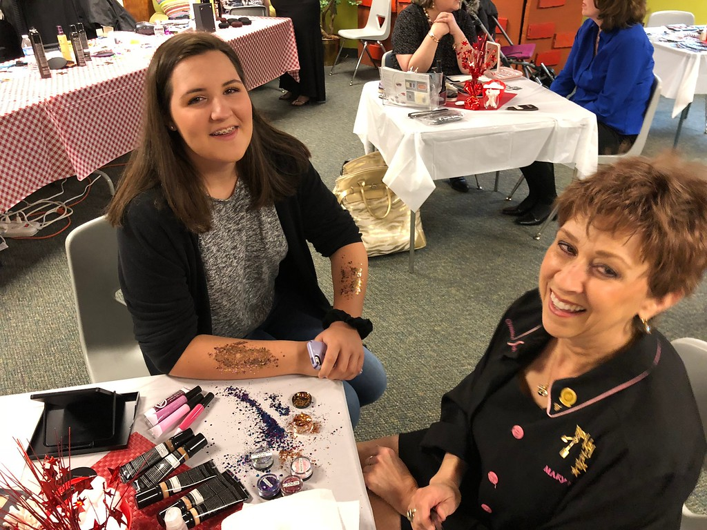 . Makeup and hairstyling was offered for guests at the Special Needs Prom at Lake Orion United Methodist Church on Friday, May 11, 2018. Pastor John Ball said the many volunteers from the church and the community make the prom a special event. Stephen Frye / Digital First Media.