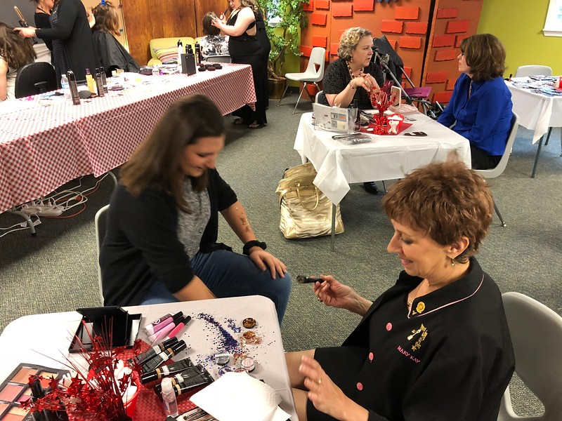 Makeup and hairstyling was offered for guests at the Special Needs Prom at Lake Orion United Methodist Church on Friday, May 11, 2018. Pastor John Ball said the many volunteers from the church and the community make the prom a special event. Stephen Frye / Digital First Media.