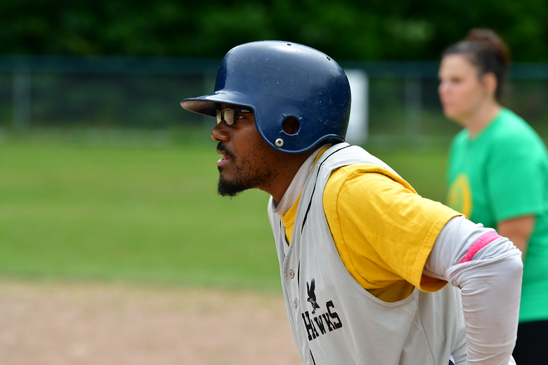 A Hawks Player has his eye on the batter after singling to open an inning.