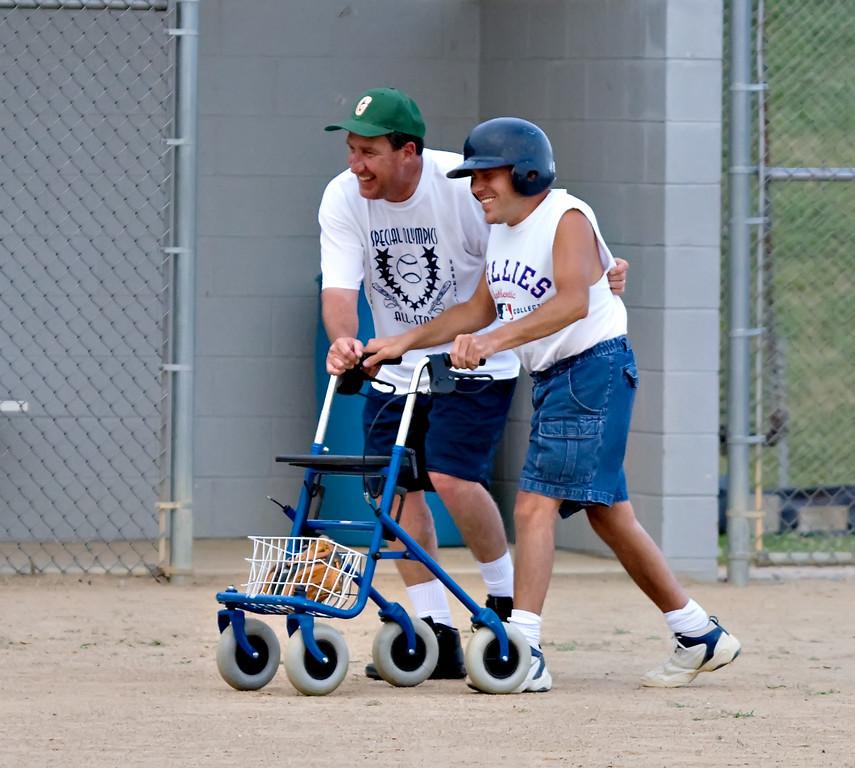 IMAGE: https://photos.smugmug.com/Special-Olympics/Special-Olympics-2007-Softball/i-v7JDZxX/0/474e216c/XL/07172007.191712.LV.SPECIAL.OLYM.S1D_6515-XL.jpg