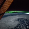 The ISS is over the North Pacific - but what are those green lights on the horizon? (ANSWER: an Aurora)