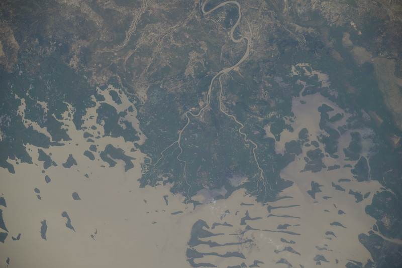 This shallow (10.5m deep) endorheic lake gives its name to 1 of 4 bordering countries and provides water for 30 million people. It's a former inland-sea and on the edge of the Sahara. ISS over Africa. (ANSWER: Lake Chad)