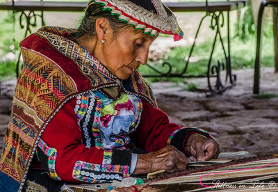 An Awanakancha weaver weaving a story out of alpaca wool dyed from various indigenous methods.