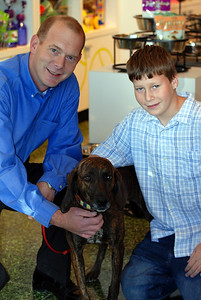 Ella  (Plott Hound,) with owners Rob & Tyler Hess, Boulder