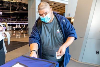 Voter Joel Acevedo casts his paper ballot at the Golden 1 Center.