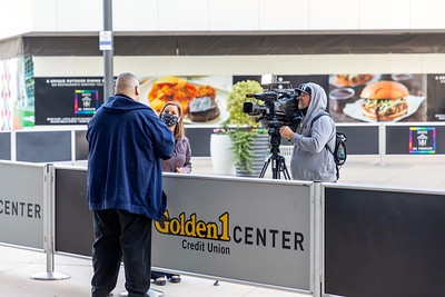 A TV news crew interviews voter Joel Acevedo as he leaves the Golden 1 Center.