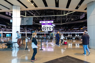 The northwest entry of the Golden 1 Center prepares to open its doors. With social distancing, the arena can accommodate 111 voters at a time — nearly 10 times the size of smaller polling places.