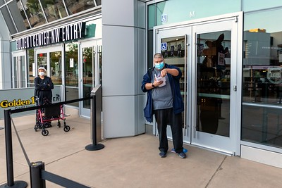 Poll observer Gloria Powell (left) waits to enter the Golden 1 Center as Joel Acevedo of Sacramento holds down the first spot in the voters line. Only three people were in the socially distanced line before the doors opened at 8 a.m.