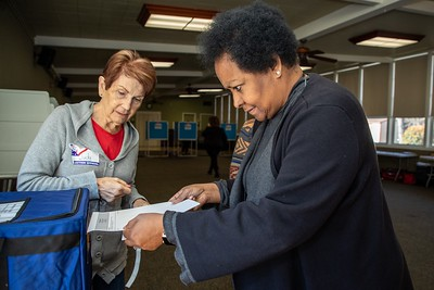 Poll worker Judy Kreizenbeck helps Renae Dunn file her ballot at the Sierra 2 Center Vote Center on March 3, 2020. (Photo by Joan Cusick)