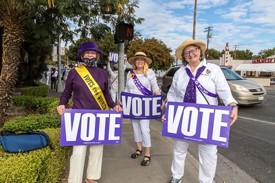 Mary Ellen Shea (left), Carol Voyles and Rosanna Herber celebrate 100 years of women's suffrage by encouraging people to vote.