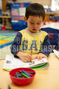 Eli Ranze, 4, colors in leters with crayons during his Pre-K class at Harold O. Brumsted Elementary School