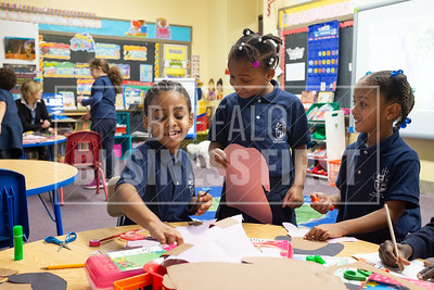 Betiel Oqbaslassie, 6, Zatayah Sommerville, 6 and Makayla Boscniarz, 6, Work in their first grade class at Our Lady of Black Rock School.