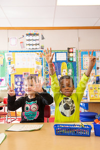 Scarlett Williamson, 6, and Light Obichie, 5, answer an question in Sarah Szymanski's kindergarten class at Ledgeview Elementary School