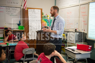 Ruby Wilson, 11, Sebastian Wickpanek, 10 and Adam Fischer pay attention toNick Patterson as he teaches persuasive writing during his 5th grade ELA class at City Honors.