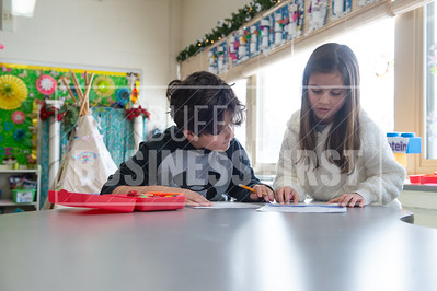 Jack and Claire Daruszka, 7, work in Karen Pasqualetti's 2nd grade  class at Harold O. Brumsted Elementary School