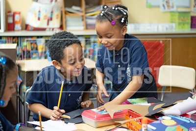 Aloniab Bisrat, 6, and Zataya Sommerville, 6, work in their first grade class at Our Lady of Black Rock School.