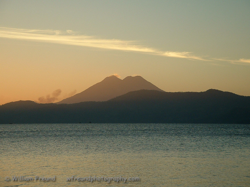 Sunrise on Lake Ilopango, El Salvador with the Chinchontepec Volcano (also known as the Volcán de San Vincente) in the background.  The lake is a crater lake so it too rests on a volcano, the Ilopango Volcano.