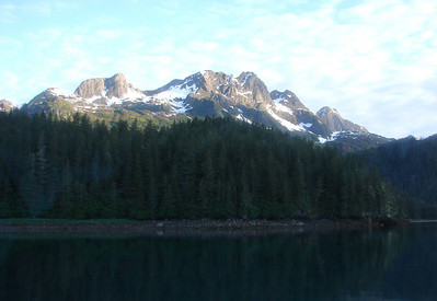 The 6:00 AM sun brightens the higher peaks surrounding Sawmill Bay.