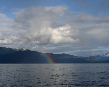 A rainbow on the east side of Port Valdez (just outside Valdez Narrows) gives promise of a brighter evening ahead.