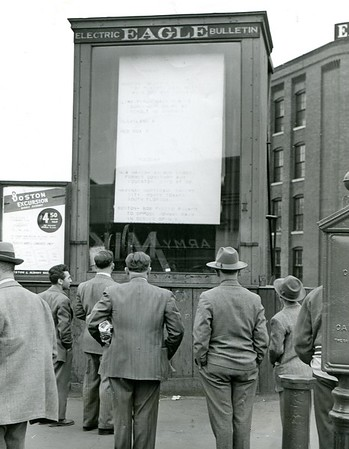 This 1951 scene shows the Electric Eagle Bulletin in front of the Eagle Building on Eagle Street.