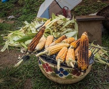 grilled corn, weekly market,. Nyasoso, Southwest Region, Cameroon Africa