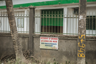 """Don't urinate on the wall"". Douala to Nyassoso, Littoral Region, Cameroon, Africa"