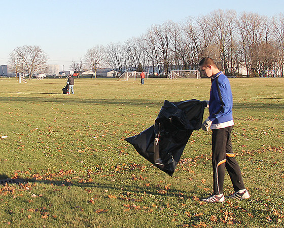Ben VanTilburg, 16, was one of several volunteers who turned out to help pick up debris from Sunday's tornado at Abner Longley Southside Park.
