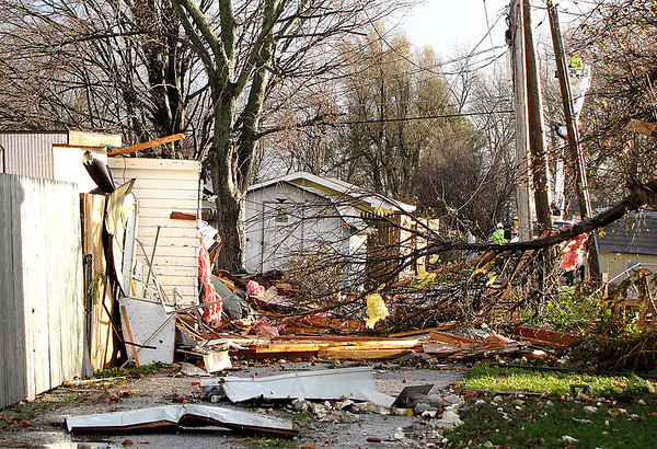 Reporter photo by Rod Rose<br /> Debris, including building insulation, trees, and utility wires, block the alley in the 1400 block between South East and South Meridian streets Sunday after a tornado hit Lebanon.
