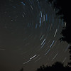 star trails in the galaxy around Cassiopeia and Capella
