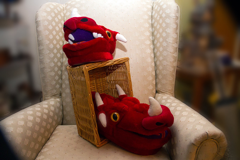 Dragon slippers, hardly used. And basket.