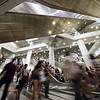 "Rush hour at Dhoby Ghaut MRT station. At least ten escalators criss-cross this underground confluence of the North-South, North-East and Circle lines.<br><span style=""font-size:75%"">©Yangchen Lin</span>"