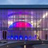 Night photo of the Whitworth Ferguson Planetarium at SUNY Buffalo State College.