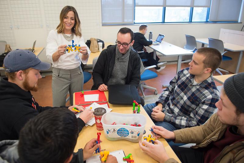 Associate professor Lorena Mathien teaching business class at SUNY Buffalo State College.