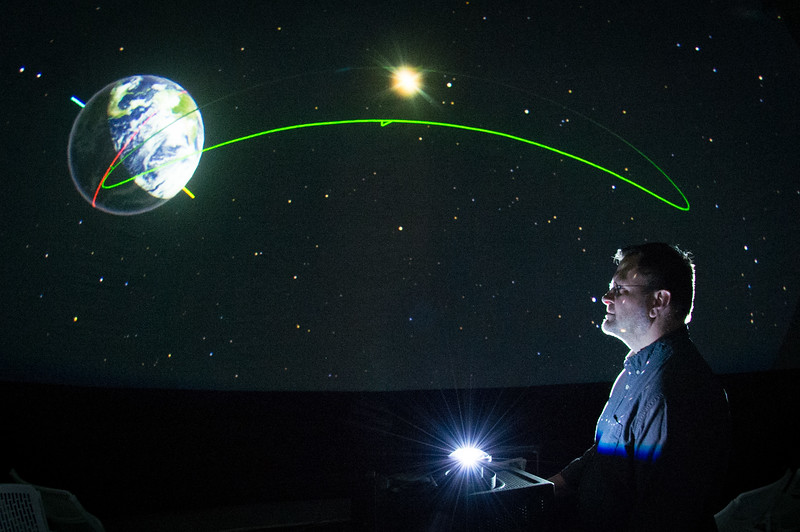 Earth Sciences and Science Education Associate Professor, Kevin Williams illustrating the winter solstice in the planetarium at SUNY Buffalo State College.