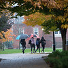 Students walking across campus at dusk  at Buffalo State College.